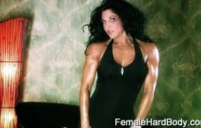 Muscle clad raven haired beauty Tracy Daniels